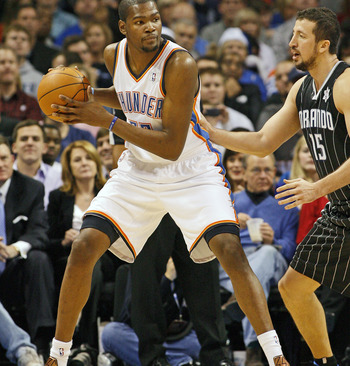OKLAHOMA CITY, OK - DECEMBER 25:  Kevin Durant #35 of the Oklahoma City Thunder looks to drive on Hedo Turkoglu #15 of the Orlando Magic during the NBA season opening game December 25, 2011 at the Chesapeake Energy Arena in Oklahoma City, Oklahoma.  Oklah