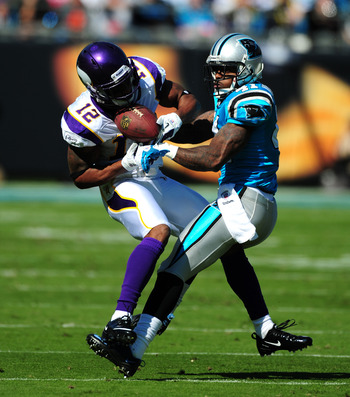 Captain Munnerlyn (41) tries to dislodge a pass intended for the Vikings' Percy Harvin (12).