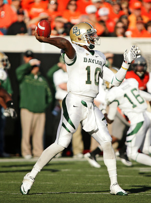 STILLWATER, OK - OCTOBER 29:  Quarterback Robert Griffin III #10 of the Baylor Bears looks to throw in the second half against the Oklahoma State Cowboys on October 29, 2011 at Boone Pickens Stadium in Stillwater, Oklahoma.  Oklahoma State defeated Baylor