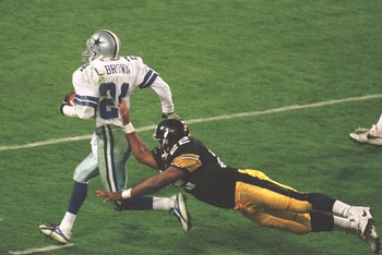 Larry Brown returns one of his two interceptions in Super Bowl XXX.
