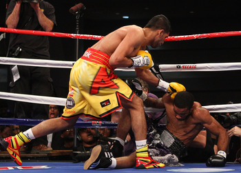 Amir Khan scores a knockdown against Lamont Peterson