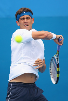 SYDNEY, AUSTRALIA - JANUARY 09:  Ryan Sweeting of the USA hits a forehand in his first round match against Gilles Muller of Luxembourg during day two of the 2012 Sydney International at Sydney Olympic Park Tennis Centre on January 9, 2012 in Sydney, Austr