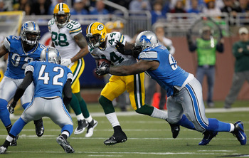 Running-back James Starks tries to escape from three Detroit defenders on Thanksgiving.