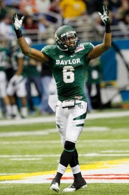 Ahmad Dixon celebrates during the Alamo Bowl