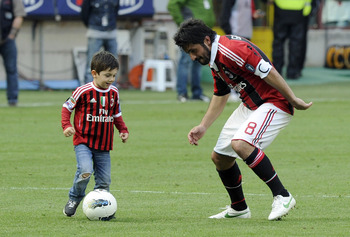 MILAN, ITALY - MAY 13:  Gennaro Gattuso and Francesco Gattuso of AC Milan after the Serie A match between AC Milan and Novara Calcio at Stadio Giuseppe Meazza on May 13, 2012 in Milan, Italy.  (Photo by Claudio Villa/Getty Images)