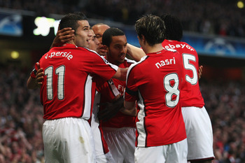 Theo Walcott celebrates with his teammates