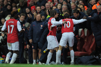 Arsenal players celebrate with Arsene Wenger