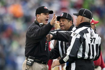 Jim Harbaugh making a point with the officials
