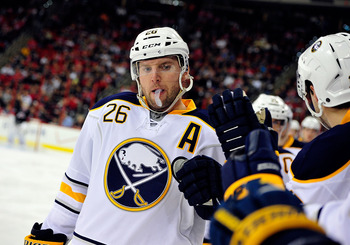 RALEIGH, NC - JANUARY 06:  Thomas Vanek #26 of the Buffalo Sabres celebrates with teammates after scoring a goal against the Carolina Hurricanes during play at the RBC Center on January 6, 2012 in Raleigh, North Carolina.  (Photo by Grant Halverson/Getty