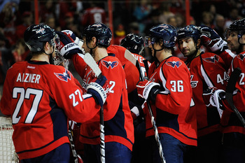 WASHINGTON, DC - JANUARY 11:  The Washington Capitals celebrate after defeating the Pittsburgh Penguins by a score of 1-0 during a game at Verizon Center on January 11, 2012 in Washington, DC.  (Photo by Patrick McDermott/Getty Images)