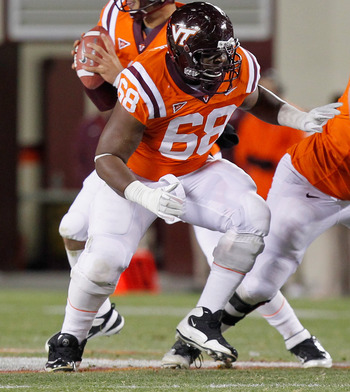 BLACKSBURG, VA - NOVEMBER 17: Jaymes Brooks #68 of the Virginia Tech Hokies blocks against the North Carolina Tar Heels at Lane Stadium on November 17, 2011 in Blacksburg, Virginia. (Photo by Geoff Burke/Getty Images)