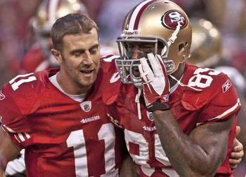 Smith and Vernon Davis celebrate their winning TD pass.