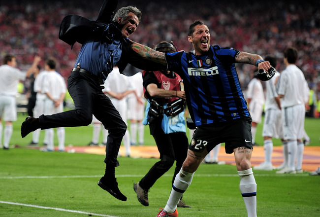 MADRID, SPAIN - MAY 22:  Head coach Jose Mourinho (L) and Marco Materazzi of Inter Milan celebrate their team's victory at the end of the UEFA Champions League Final match between FC Bayern Muenchen and Inter Milan at the Estadio Santiago Bernabeu on May