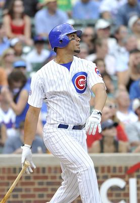 CHICAGO, IL - JUNE 27:  Carlos Pena #22  of the Chicago Cubs watches his two-run homer scoring Aramis Ramirez during the fifth inning against the Colorado Rockies at Wrigley Field on June 27, 2011 in Chicago, Illinois.  (Photo by Brian Kersey/Getty Images
