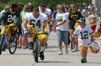 Hopefully no players take on the superstition of riding kids' bikes beyond training camp into the regular season! Ouch!