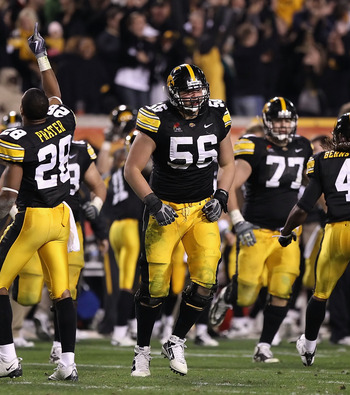 Iowa OT Markus Zusevics (center)