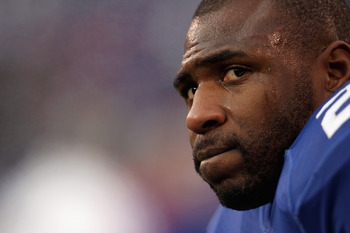 EAST RUTHERFORD, NJ - JANUARY 08:  Brandon Jacobs #27 of the New York Giants looks on against the Atlanta Falcons during their NFC Wild Card Playoff game at MetLife Stadium on January 8, 2012 in East Rutherford, New Jersey.  (Photo by Nick Laham/Getty Ima