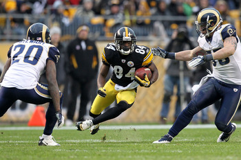 PITTSBURGH, PA - DECEMBER 24:  Wide receiver Antonio Brown #84 of the Pittsburgh Steelers rushes for yards after a catch during the game against the St. Louis Rams at Heinz Field on December 24, 2011 in Pittsburgh, Pennsylvania. Brown broke the Pittsburgh