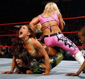 Natalya-locks-eve-and-layla_display_image