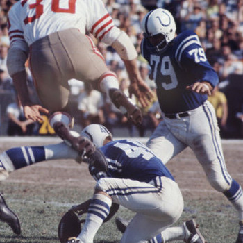 Art-rickerby-baltimore-colts-foorball-player-lou-michaels-about-to-kick-the-ball-with-his-left-foot-and-score_display_image
