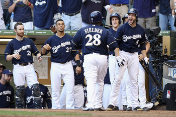 MILWAUKEE, WI - OCTOBER 09:  Prince Fielder #28 of the Milwaukee Brewers celebrates with teammates including Ryan Braun #8 after Fielder hit s 2-run home run in the bottom of the fifth inning against the St. Louis Cardinals during Game one of the National