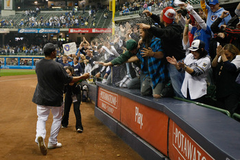 MILWAUKEE, WI - SEPTEMBER 23:  Carlos Gomez #27 of the Milwaukee Brewers sprays fans with champagne to celebrate after the game against the Florida Marlins at Miller Park on September 23, 2011 in Milwaukee, Wisconsin. The Brewers defeated the Marlins 4-1.