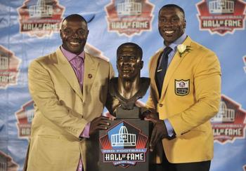 Shannon-and-sterling-sharpe-with-bronze-bust_4_display_image
