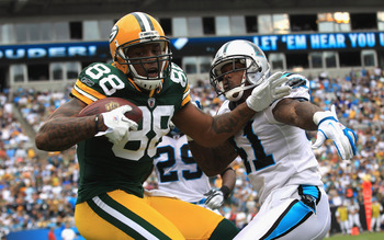 CHARLOTTE, NC - SEPTEMBER 18:   Jermichael Finley #88 of the Green Bay Packers tries to make a catch against Captain Munnerlyn #41 of the Carolina Panthers during their game at Bank of America Stadium on September 18, 2011 in Charlotte, North Carolina.  (