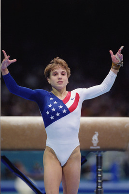 ATLANTA - JULY 23:  Kerri Strug of the United States sticks the landing on her second attempt while competing in the vault, part of the Womens Team Gymnastics competition at the 1996 Olympic Games on July 23, 1996 at the Georgia Dome in Atlanta, Georgia.