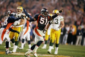 John Mobley celebrates after batting Brett Favre's final pass away.