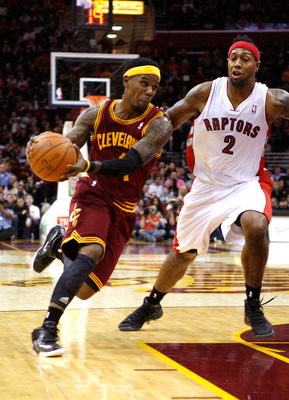 CLEVELAND, OH - DECEMBER 26:  Daniel Gibson #1 of the Cleveland Cavaliers drives to the basket against James Johnson #2 of the Toronto Raptors during the season opener at Quicken Loans Arena on December 26, 2011 in Cleveland, Ohio. NOTE TO USER: User expr