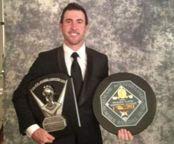 Justin Verlander shows off his MVP and Cy Young awards.