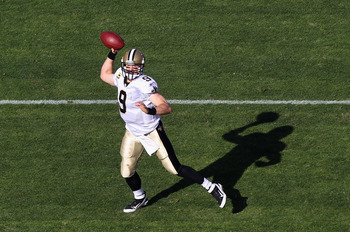 Drew Brees throws a pass during New Orleans' loss to San Francisco in his record-setting season.