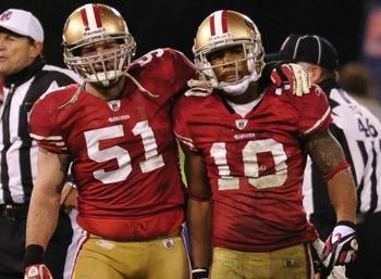 Teammate Blake Costanzo (51) embraces Kyle Williams.