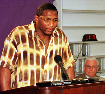 370715_04: Baltimore Ravens linebacker Ray Lewis speaks during a press conference as team owner Art Modell looks on June 9, 2000 at the team's training complex in Owings Mills, Md. The murder charges that against Lewis were dropped and he wanted to close