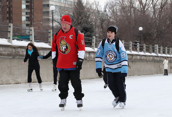 OTTAWA, ON - JANUARY 26:  Fans of the Ottawa Senators and Pittsburgh Penguins skate on the Rideau Canal before the NHL Trophy Presentation as part of NHL All Star weekend on January 26, 2012 in Ottawa, Ontario, Canada.  (Photo by Christian Petersen/Getty