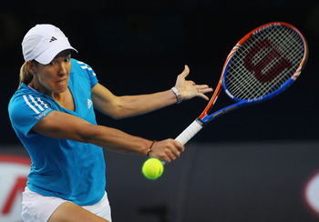 Justine Henin and her classic one-handed backhand, the most beautiful stroke in the sport.
