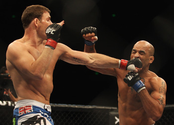 Michael Bisping (left) connects against Jorge Rivera