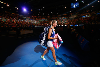 MELBOURNE, AUSTRALIA - JANUARY 28:  Victoria Azarenka of Belarus exits Rod Laver arena after winning her women's final match against Maria Sharapova of Russia, and being named world number one, during day thirteen of the 2012 Australian Open at Melbourne