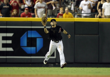 PHOENIX, AZ - AUGUST 13:  Outfielder Gerardo Parra #8 of the Arizona Diamondbacks catches a fly ball out against the New York Mets during the Major League Baseball game at Chase Field on August 13, 2011 in Phoenix, Arizona.  The Diamondbacks defeated the