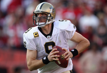 SAN FRANCISCO, CA - JANUARY 14:  Drew Brees #9 of the New Orleans Saints looks to pass from the pocket against the San Francisco 49ers during the NFC Divisional playoff game at Candlestick Park on January 14, 2012 in San Francisco, California. The 49ers w