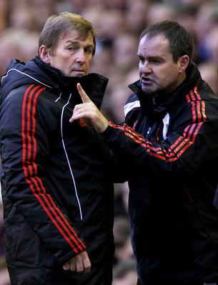 Kenny Dalglish getting advice from Steve Clarke
