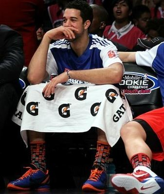 Blake_griffin_has_a_laugh_with_landry_fields_on_the_bench_during_the_rookie_sophomore_game_2011_display_image