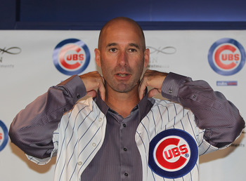 CHICAGO, IL - NOVEMBER 18:  Dale Sveum, the new manager of the Chicago Cubs, tries on a jersey during a press conference at Wrigley Field on November 18, 2011 in Chicago, Illinois.  (Photo by Jonathan Daniel/Getty Images)