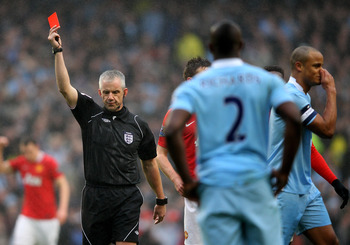 Kompany is shown a red card by referee Chris Foy