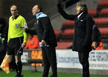 Mancini gestures towards the referee