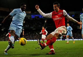 Kolo Toure blocks RVP's cross v Arsenal