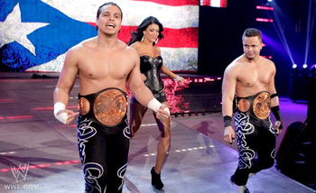 Current Tag Team Champions, The Colons with Rosa Mendes