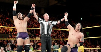 The-usos-after-winning-a-match-at-nxt_display_image