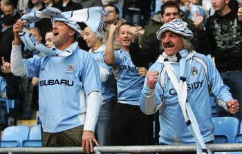 Coventry City fans cheer on the Sky Blues